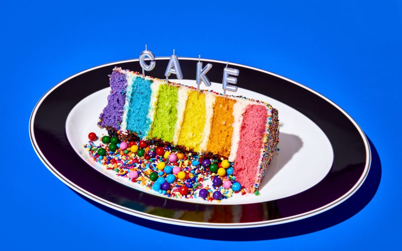 Rainbow cake slice on a plate